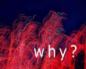 Abstract red colored neon lights with the word Why uid 1647863