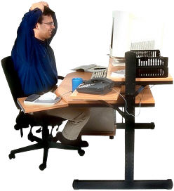 man at a computer desk uid 1053387