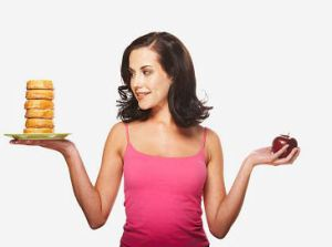 Woman Deciding Between Apple and Donuts uid 1963735