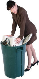 woman professional stuffing computer in garbage uid 1088444