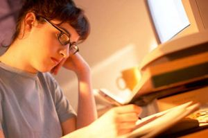 Student studying at desk uid 1427249