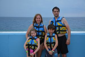Swimming with dolphins during our trip to Grand Cayman.