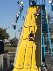 Jase and Lexie on the tall slide.