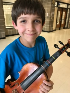 My son rocks the school district orchestra competition